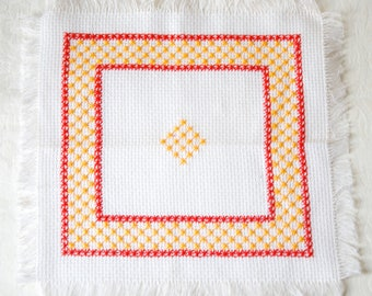 FESTIVE EMBROIDERED PANEL for home decor. Vintage doily or picture with yellow stars & red motifs