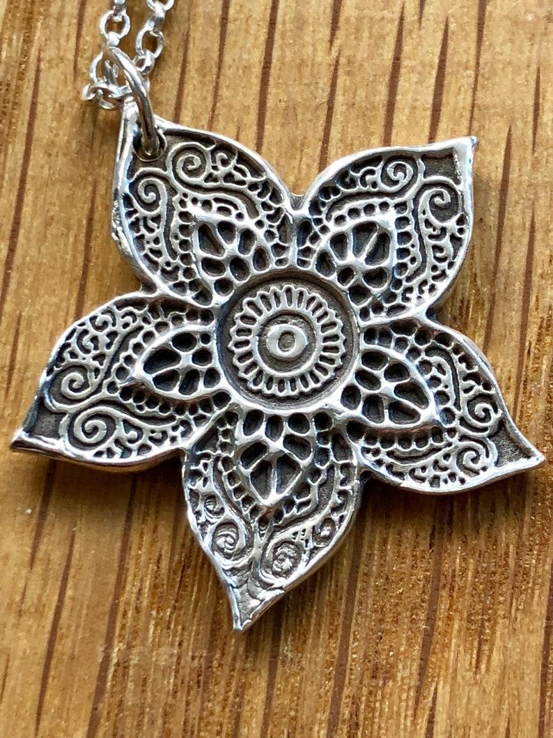 spinning Mehndi Beautiful Handmade Silver Henna Flower pendant and drop spinning earring set spinning earrings earrings silver henna
