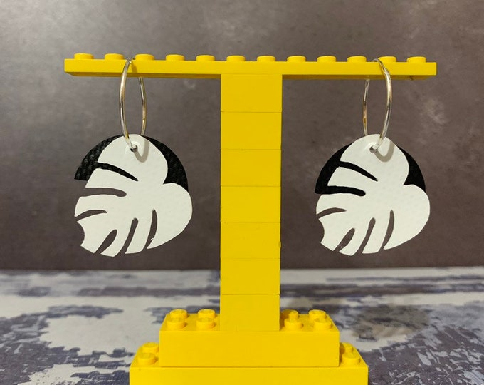 Featured listing image: Leaf Earrings Bouncy Castle PVC | sterling silver | rescued materials | Monstera | upcycled | White + Black