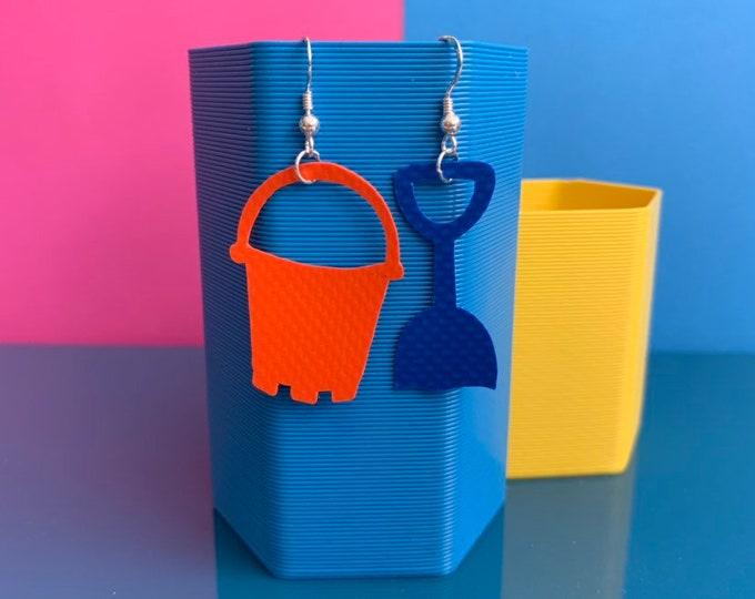 Featured listing image: Bouncy Castle Earrings | Orange + Blue | recycled broken bouncy castle PVC Bucket and Spade + sterling silver | seaside