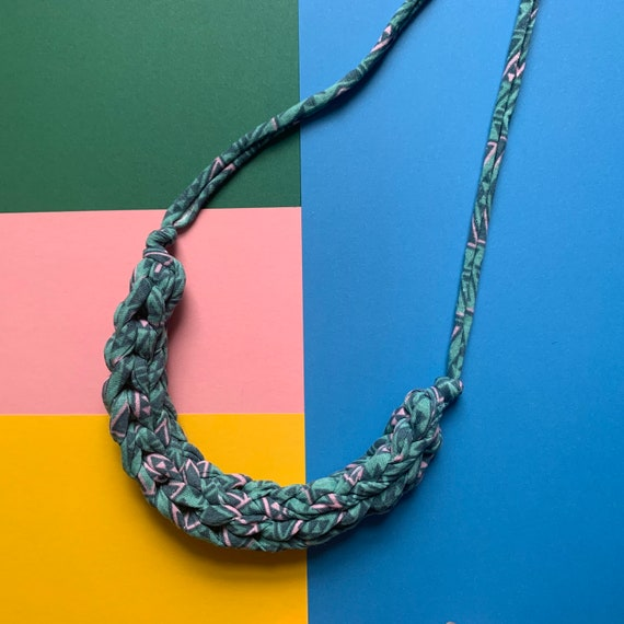 Stellen Curve necklace: Geometric teal and pink chunky statement necklace made with patterned Tshirt yarn