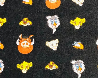 The Lion King Character Heads Black Fabric by the yard and half yard and other various lengths