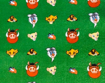 The Lion King Character Heads Green Fabric by the yard and half yard and other various lengths