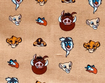 The Lion King Character Heads Gold Fabric by the yard and half yard and other various lengths