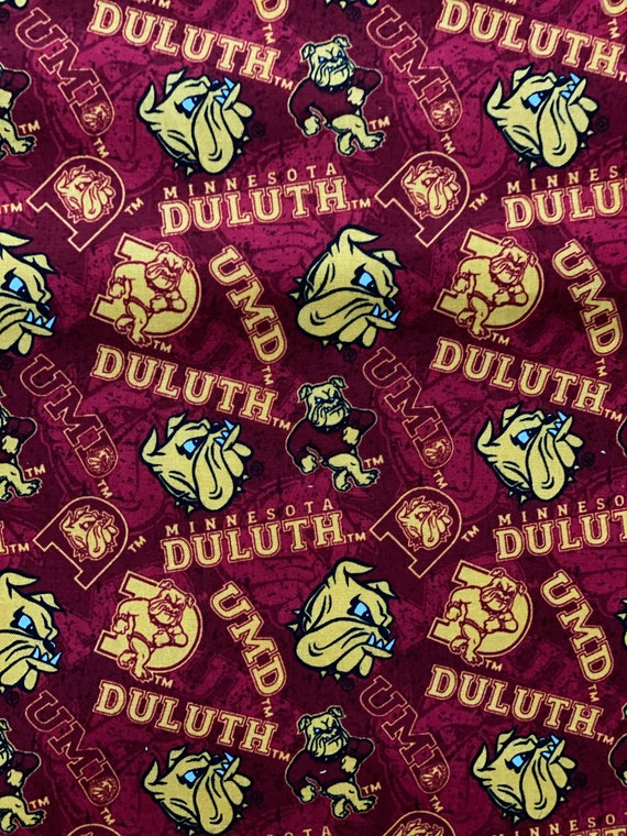 UMD Faberic, University of Minnesota Duluth red plaid fabric in various lengths