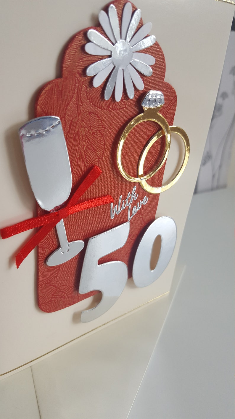 silver and gold on a cream card golden 50th wedding anniversary card in red