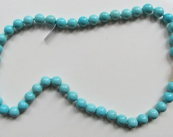 Turquoise necklace with two-tone gold clasp