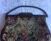 Vintage woolwork tapestry hand bag. Fabulous floral woolwork. Leather handle, leather covered metal frame, carved wooden clasp.