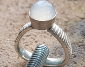 Shaded silver ring with ball-cut moonstone
