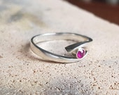 Subtle wrought ring with Ruby 3, 1mm