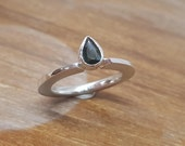 Pear shaped facet cut sapphire in handmade formeing shiny and custom made