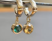 Playful creoles with two colors set gemstones and 14k golden = characters.