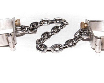 D - Manacles & removable chain.