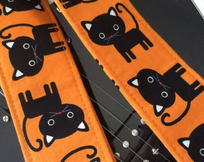 Black cat guitar strap // cool cats on orange guitar strap // rock and roll/rockabilly guitarist gift // black cat girls guitar strap