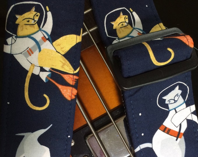 Cats in space guitar strap // cool feline astronomical nostalgia // glow-in-the-dark astrocats in spacesuits, walking in space