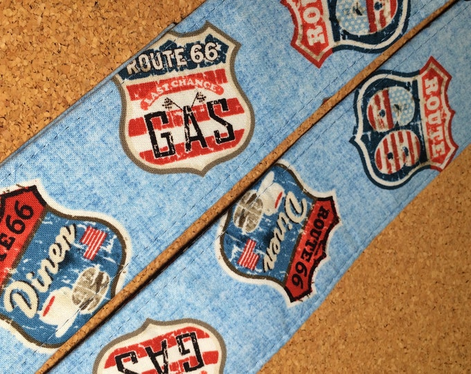 Road signs guitar strap // retro route indicator images on light denim blue colour // shield-shaped Route 66, diner, last chance gas