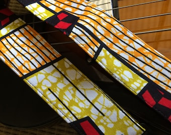 African wax print guitar strap // vibrant graphic colours abstract yellow, red, lime, black and white // suits acoustic, electric or bass