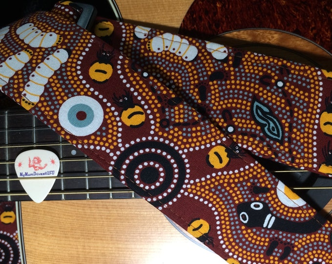 Aboriginal dot-pattern guitar strap // traditional circles design in shades of brown, yellow, black, white // acoustic electric bass guitar