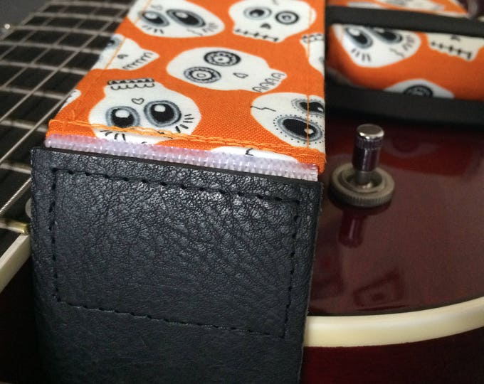 Skull guitar strap // glow in the dark Halloween ghost skulls on an orange background // unique guitar strap // guitarist gift for her
