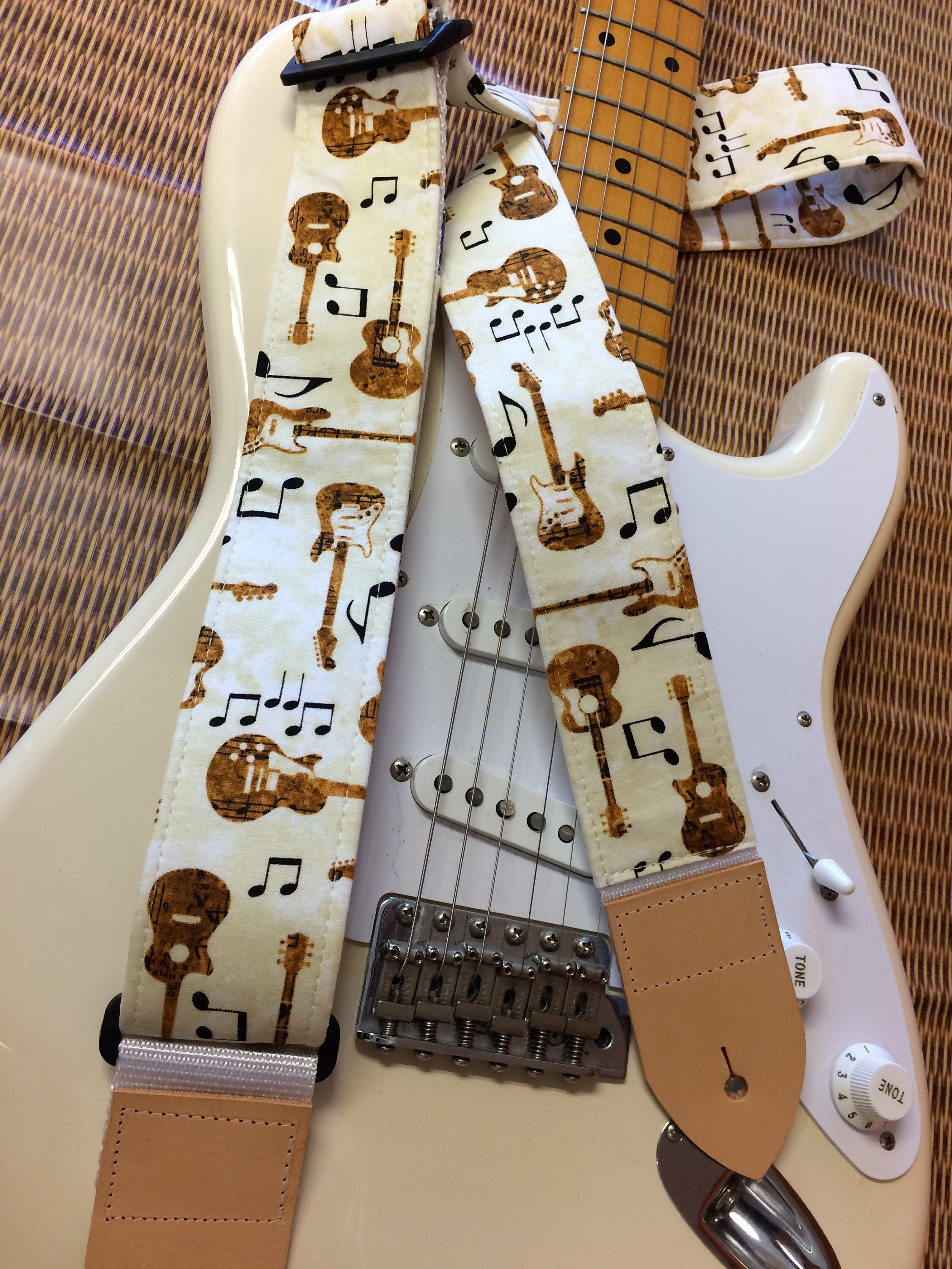 Music Guitar Strap Guitars And Musical Symbols On A Cream