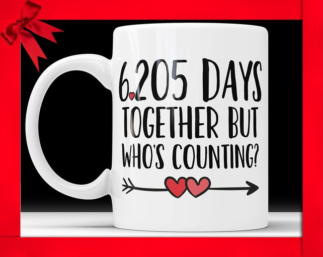 17th anniversary coffee mug 6205 days together but whos etsy
