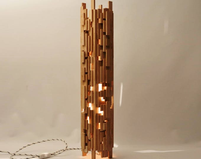 Chaoss Design lamp in recycled oak wood.