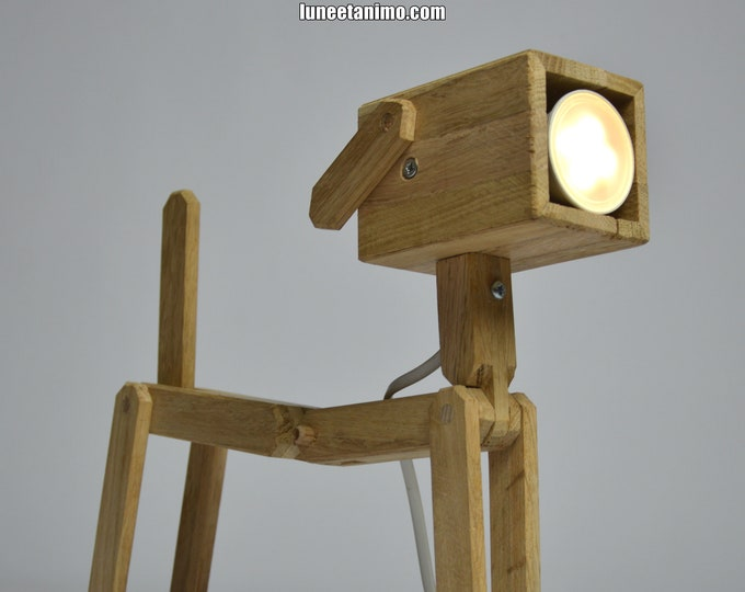 DOG // Articulated wooden design lamp in the shape of a dog.