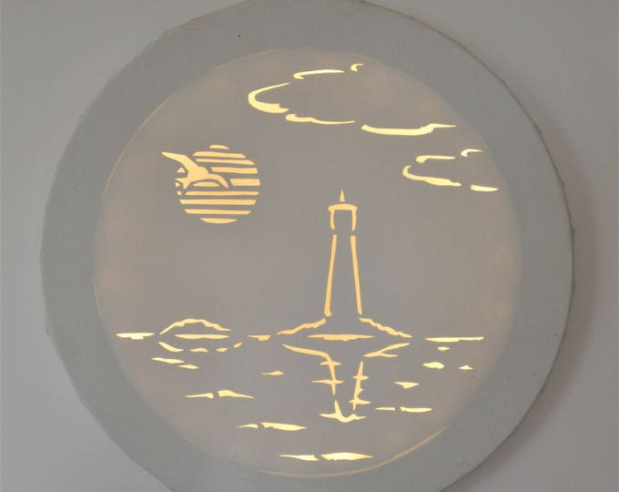 Led cut round canvas art 'Hublot of lighthouse'