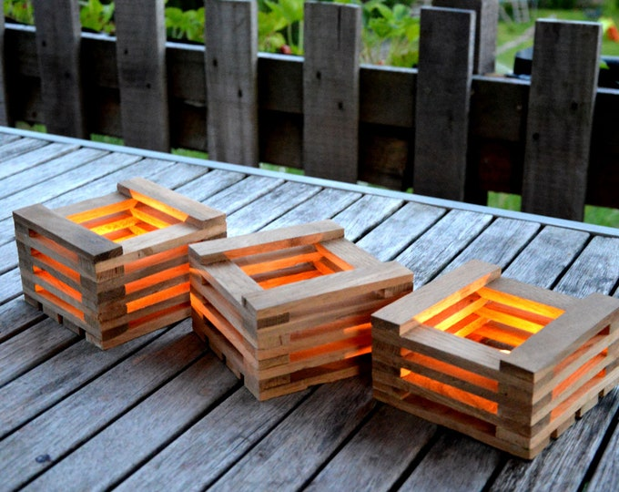3cubes // Photophores in recycled wood outdoor decoration