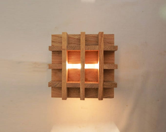 Design wall light in oakwood, Wall light in the shape of dice, a modern square design, recycled wood. Zare made in France by Lune et Animo