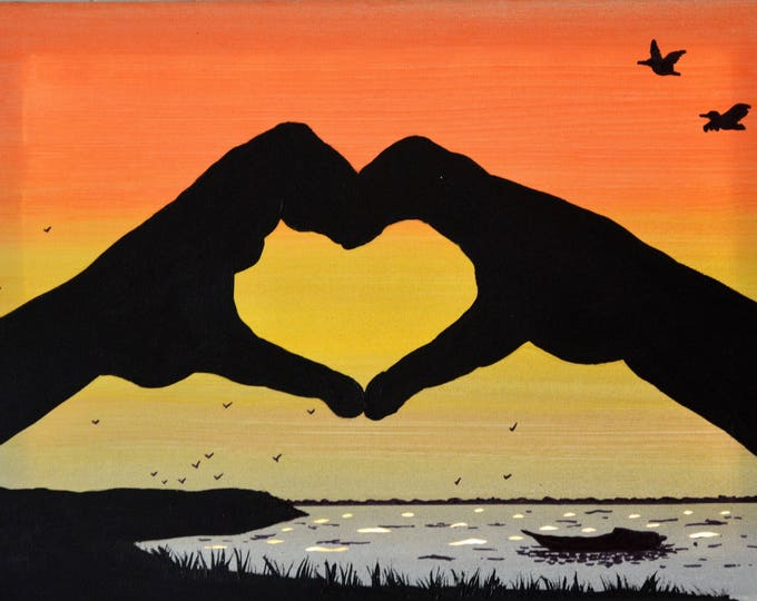 Led canvas art 'Hands in heart on sunset'