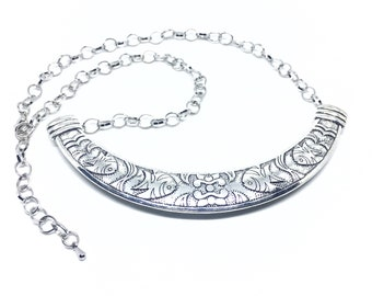 Fish silver necklace.