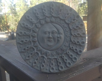 Sun and moon garden art