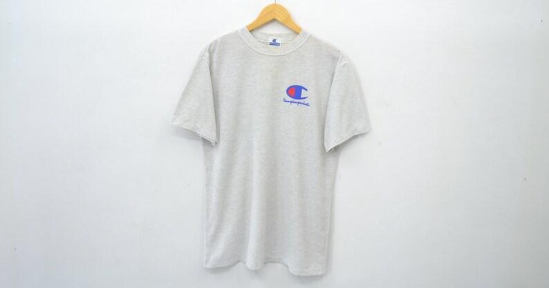 ca84917f7da7 Champion Tee Shirt Vintage 90's Champion Small Logo Tee   Etsy