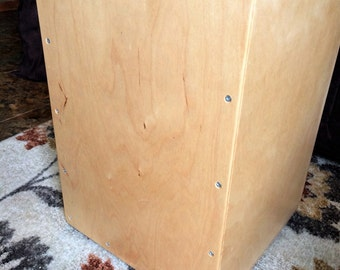 Cajon Drum with Snare and Pad. Use for Music accompaniment, Drum Circles, or bang out beats in solitude. Cajon translates to box or crate.