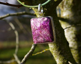Charoite pendant heals emotional wounds