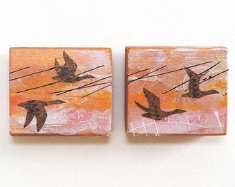 Geese wall art diptych, mixed media collage on small reclaimed wood blocks, geese in flight, wildlife, orange and gold, gift for birder