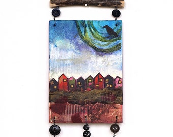 Mixed media art wall hanging, fantasy landscape with little houses and crow, whimsical outsider art assemblage