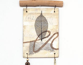Mixed media art wall hanging, reclaimed plywood and branch, abstract collage with black leaf, rustic decor assemblage