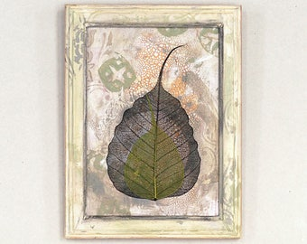 Mixed media wall art, reclaimed plywood and recycled frame, neutral colors, black and green leaves, zen decor