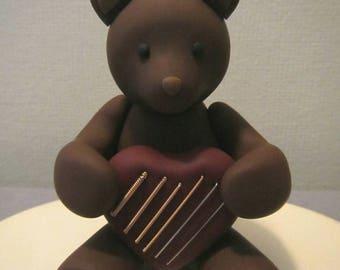Handmade teddy bear holding a heart