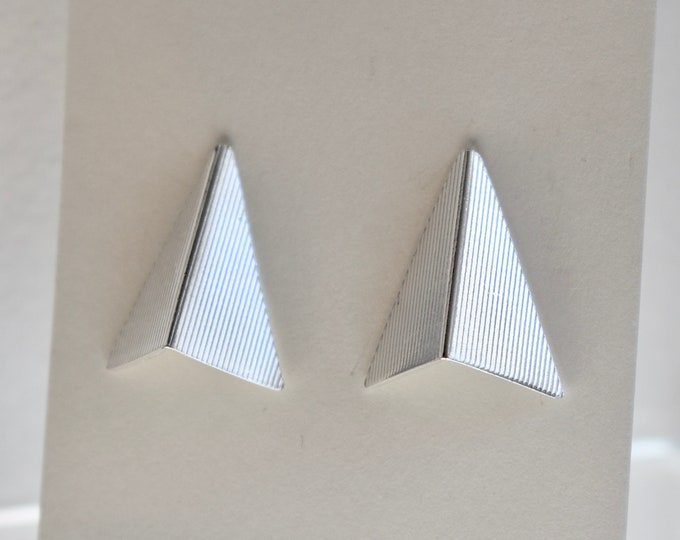 Featured listing image: Silver arrow stud earrings, textured.