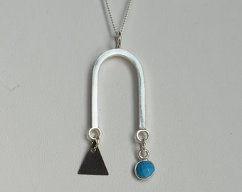 Turquoise and sterling silver long graphic necklace