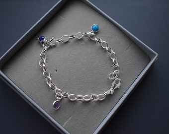 Turquoise, Sapphire and Amethyst Sterling silver charm bracelet, oval links.