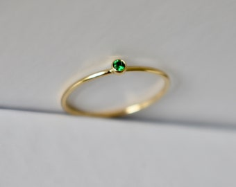 Dainty Gold filled stacking ring with a 2mm green cubic zirconia.