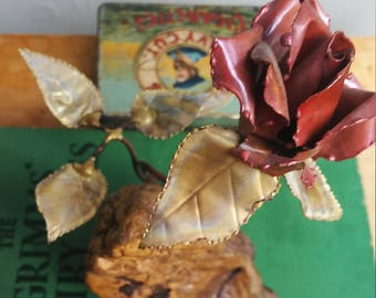 copper brass flower sculpture on burl wood / rose