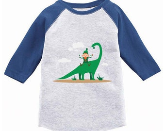 9965677b St. Patrick's Day Shirt Kids. Irish Leprechaun and Dinosaur Toddler Raglan.