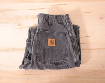 Vintage faded black Carhartt carpenter pants
