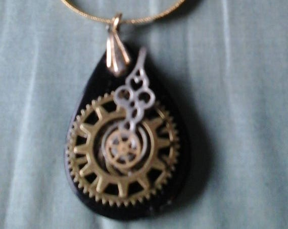 Steampunk Necklace; Black Onyx-like Tear Drop Pendant with Gears and Watch Arm on Golden Chain, Steampunk Jewelry, Steampunk Gift