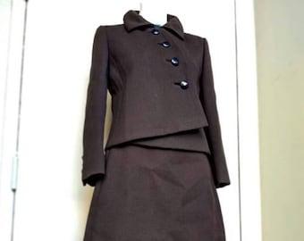 Beautiful 1960s Chocolate brown wool double-knit 2 piece suit by Nan Duskin Philadelphia. Asymmetrical closure on the jacket & A-line skirt
